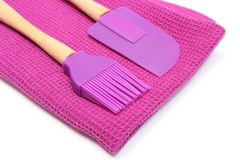 Purple silicone kitchen accessories on white background Royalty Free Stock Photo