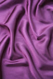 Purple silk. With frill flow Royalty Free Stock Image