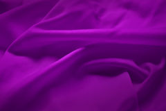 Purple silk. Beautiful and smooth silk background Stock Photography