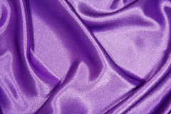 Purple silk cloth with folds Stock Photo