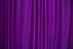 Purple curtain. Purple silk curtain as a background Stock Photography