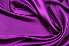 Purple silk fabric. Closeup of rippled purple silk fabric Royalty Free Stock Image