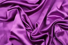 Purple silk fabric. Closeup of rippled purple silk fabric Royalty Free Stock Photography