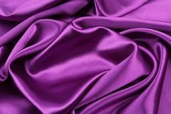 Purple silk fabric. Closeup of rippled purple silk fabric Stock Photos