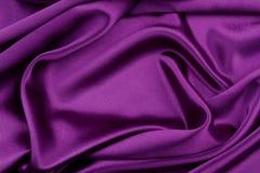 Purple silk fabric. Closeup of rippled purple silk fabric Stock Photography