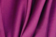 Purple silk texture. Purple colour silk fabric texture Stock Photo