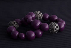 Purple and silver bracelets Stock Photos