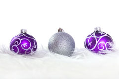 Purple and silver christmas baubles Royalty Free Stock Photos