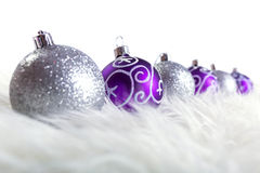 Purple and silver christmas baubles. Over white background Stock Images