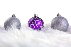 Purple and silver christmas baubles Royalty Free Stock Photography