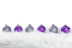 Purple and silver christmas baubles Royalty Free Stock Image
