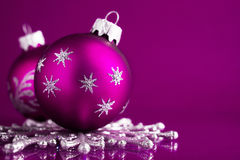Purple and silver christmas ornaments on dark purple xmas background. With space for text Royalty Free Stock Photography
