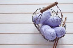 Purple skeins of cotton yarn in a basket Royalty Free Stock Photo