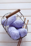 Purple skeins of cotton yarn in a basket Stock Photo