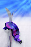 Purple Ski Goggles & Skis Royalty Free Stock Photography