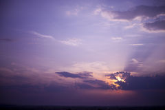 Purple sky. Beautiful purple sky with sun setting down od right Royalty Free Stock Image