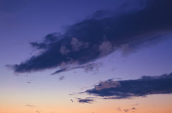 Purple Sky And Clouds. Sky details during sunset, purple, blue and orange colors Royalty Free Stock Image