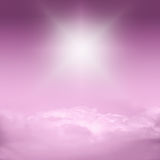 Purple sky, clouds and sun. Abstract background Royalty Free Stock Photos