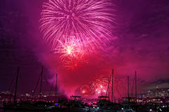 Purple sky fireworks over boats Royalty Free Stock Photos