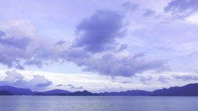 Purple sky, mountain and peaceful lake Royalty Free Stock Images