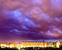 Purple sky storm industrial city lights night. Purple sky storm industrial city night Royalty Free Stock Images