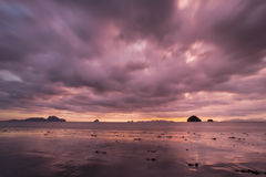 Purple sky. Sunset at the beach of Thailand with purple sky stock photos