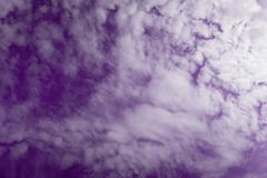 Purple sky. Texture of beautiful purple sky and white clouds Stock Photography