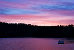 Purple sky with water reflections and swim jetty Royalty Free Stock Images