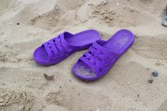 Purple slippers on the beach Royalty Free Stock Photos