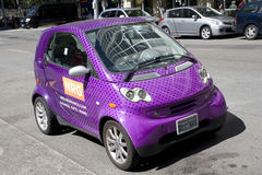 Purple small smart electric car Royalty Free Stock Photo