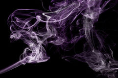 Purple Smoke Abstract. An abstract image of purple smoke set against a black background Stock Photo