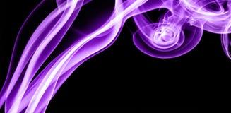Purple smoke in the black Background Stock Photos