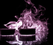 Purple Smoke from Candles Royalty Free Stock Image