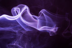 Purple smoke isolated on a black background stock photo