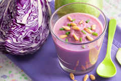 Purple smoothie. Of red cabbage, apple, lemon and pine nuts Royalty Free Stock Photo