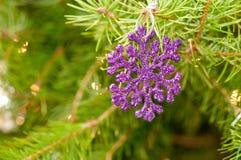 Purple snowflake shaped ornament stock photos