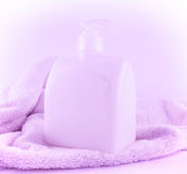 Purple soap and towel Royalty Free Stock Photos