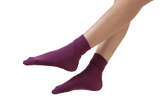 Purple socks. Feet with purple socks over white Stock Images