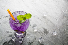 Purple soda lime drink with lime. On stone Stock Photo