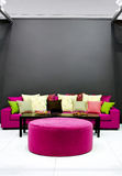 Purple sofa Stock Images