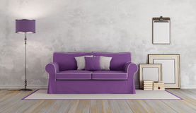 Purple sofa in a classic room Stock Image