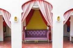 Purple sofa Stock Images