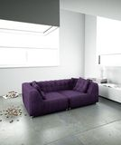 Purple sofa in minimalist interior Royalty Free Stock Photos