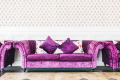 Purple sofa with pillow Royalty Free Stock Photography