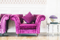 Purple sofa with pillow Stock Photos