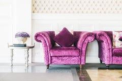 Purple sofa with pillow Stock Photo