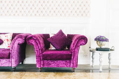 Purple sofa with pillow Stock Photography