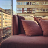 Purple sofa in a room with city view Stock Photo