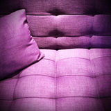 Purple sofa under the light Stock Photos