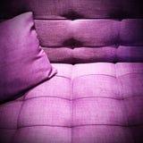 Purple sofa under the light Stock Photos